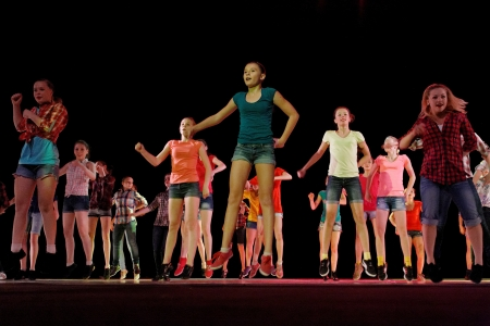 improvisation: DNEPROPETROVSK,UKRAINE - JUNE 3, 2013 - School-theatre of Modern dance POTOKI,Dnepropetrovsk  Adults and teenagers class dancers perform hip hop composition at Summer Annual Entertainment  A Workshop of Smiles