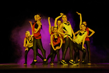 DNEPROPETROVSK,UKRAINE - December 7, 2013 - School-theatre of Contemporary dance POTOKI, Dnepropetrovsk Teenager class dancers perform a composition Want to fly, Let s dance in Winter Annual Entertainment  Fusion