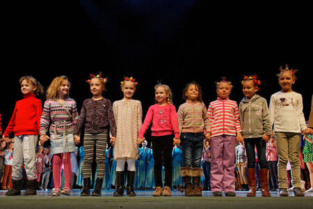 frienship: DNEPROPETROVSK,UKRAINE - December 7, 2013 - School-theatre of Contemporary dance POTOKI, Dnepropetrovsk Children class dancers at after-show rewarding  in Winter Annual Entertainment  Fusion   Editorial