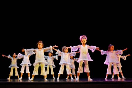 DNEPROPETROVSK,UKRAINE - DECEMBER 13, 2014 - School-theatre of Contemporary dance POTOKI, Dnepropetrovsk  Children class dancers perform at  Winter Annual Entertainment  Let the Sun in