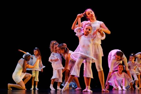 adult entertainment: DNEPROPETROVSK,UKRAINE - DECEMBER 13, 2014 - School-theatre of Contemporary dance POTOKI, Dnepropetrovsk  Children and Adult classes dancers perform at  Winter Annual Entertainment  Let the Sun in