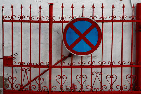 twiddle: no driving traffic sign on a red metal fence