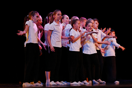 improvisation: DNEPROPETROVSK,UKRAINE - December 13, 2014 - School-theater of Contemporary dance POTOKI, Dnepropetrovsk Teens class dancers perform a composition Let the sun in
