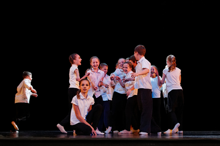 improvisation: DNEPROPETROVSK,UKRAINE - December 13, 2014 - School-theater of Contemporary dance POTOKI, Dnepropetrovsk Teens class dancers perform a composition School at Winter Annual Entertainment Let the sun in