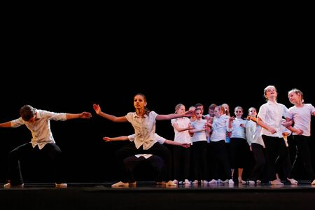 DNEPROPETROVSK,UKRAINE - December 13, 2014 - School-theater of Contemporary dance POTOKI, Dnepropetrovsk Teens class dancers perform a composition School at Winter Annual Entertainment Let the sun in