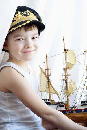 Portrait of the young boy with the model ship Stock Photo - 6628785