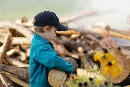 Young village boy bringing hard firewood Stock Photo - 6661561
