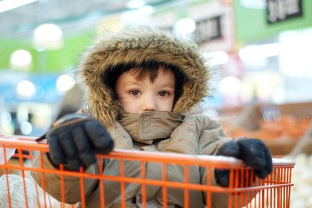 tedium: Little boy in shopping cart Stock Photo