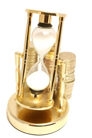 Golden hourglass with coins