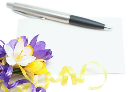 Multicolor bouquet of crocuses with pen and ribbons photo