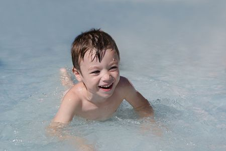 Small boy in swimming pool; summer fun  photo
