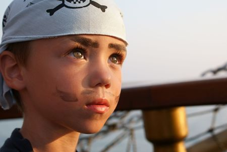 Portrait of little pirate on pirate�s ship