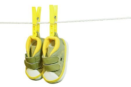 bootee: Green baby�s bootee hanging on the clothesline