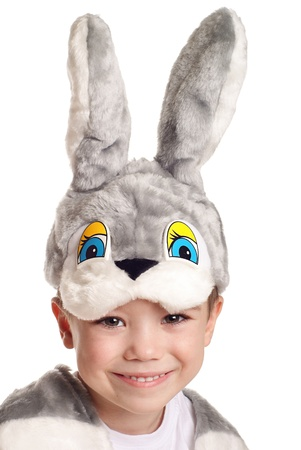 Close-up portrait of small boy in hare costume isolated on white background