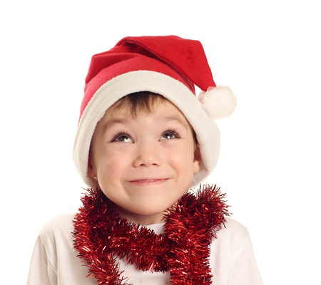 Little boy with Santa Claus hat isolated on white background photo