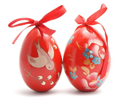 Two hand painted Easter eggs isolated on white background photo