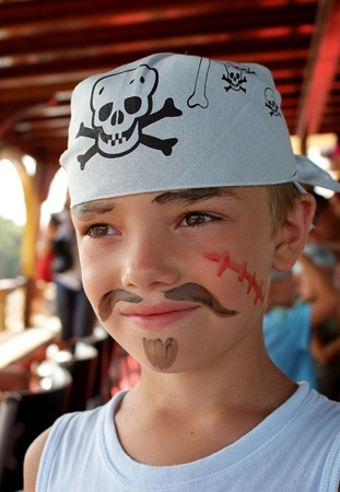 Portrait of young pirate on pirate�s ship