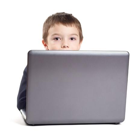 Junge im Anzug mit Laptop isolated on white background