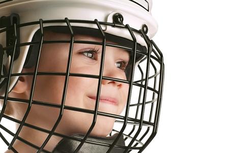 Boy in hockey helmet photo