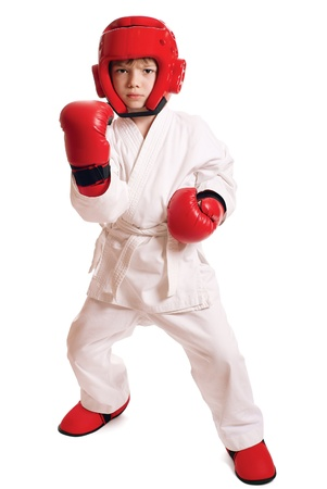 Young boy in kimono ready to fight over pure white background Stock Photo - 9997158