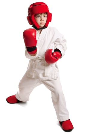 Young boy in kimono ready to fight over pure white background Stock Photo - 9997154