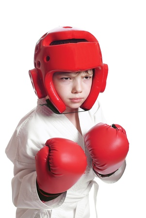 Young boy in kimono ready to fight on pure white background Stock Photo - 9997183