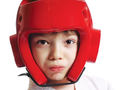 Portrait of young boy in helmet with gum shield isolated on pure white background Stock Photo - 9997160