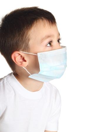 Boy in medicine mask