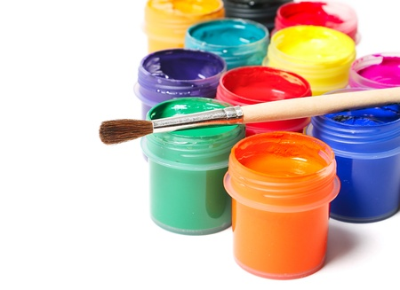 Multicolor paints and paintbrush on white background photo