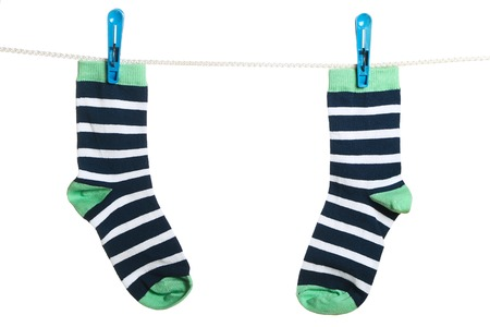 Pair of striped socks hanging on the clothesline. Image isolated on white background photo