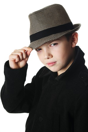Young boy wearing a hat on white background