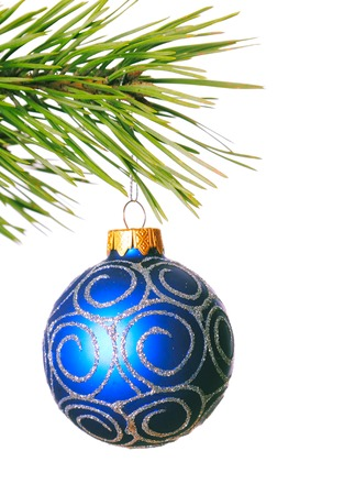 Christmas ball on pine branch; white background Stock Photo
