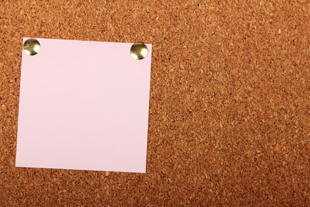 Note paper with pin on cork board Stock Photo