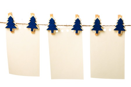 Clothes-peg in shape of Christmas tree isolated on white background photo