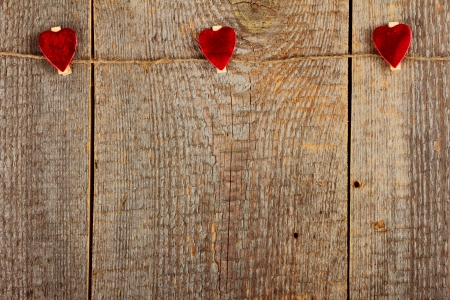 clothespeg: Clothes-peg in shape of heart on old wooden background Stock Photo