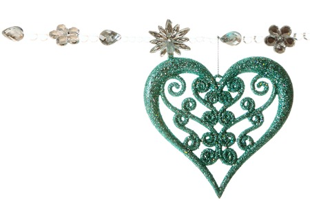 Garland with Christmas bauble in shape of heart isolated on white background photo