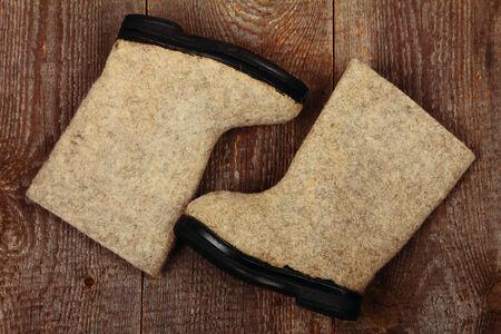 valenki: Russian traditional winter felt boots valenki on wooden background