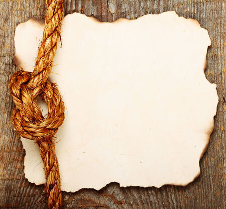 Old crushed paper on brown wooden background. Stock photo photo