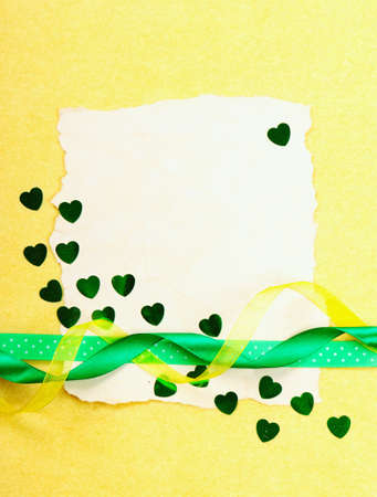 Valentines day card. Old paper with decorations on yellow background. Stock photo photo