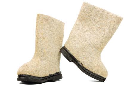valenki: Russian traditional winter felt boot valenki on white background. Stock photo Stock Photo