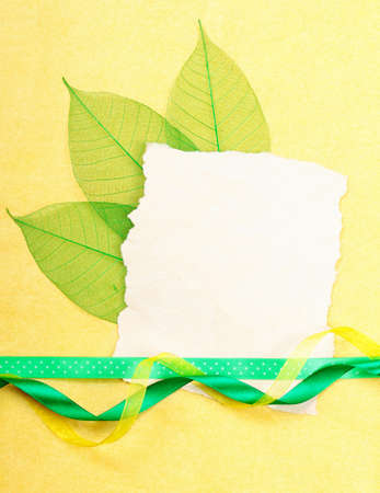 Holidays card. Old paper with ribbons on yellow background. Stock photo photo