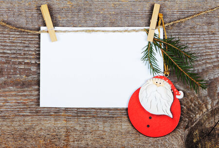 Empty greeting card with Santa on old wooden background photo
