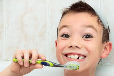 seven years: Seven years boy is brushing his teeth
