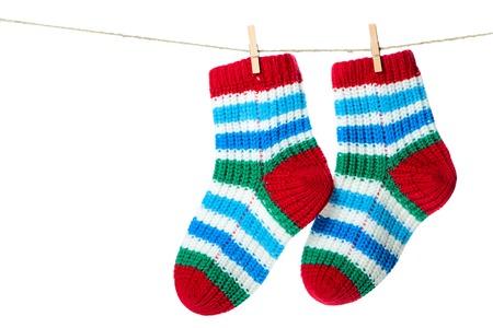 Colorful socks hanging on the clothesline. Image isolated on white background photo