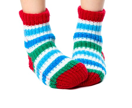 clothed: Children feet clothed in colorful socks isolated on white background