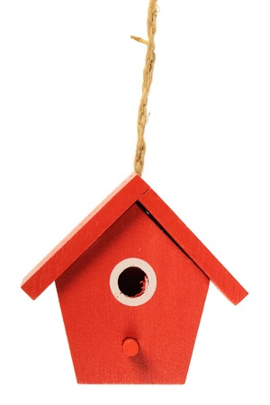 One painted birdhouse hanging on white background