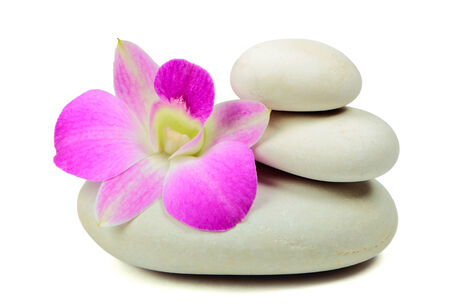 Pyramid of the stones with orchid on white background photo