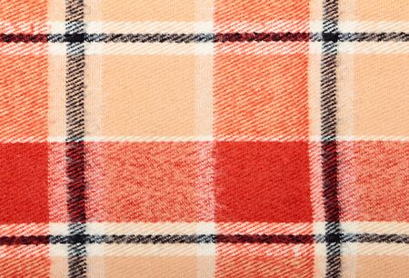 Checkered wool scarf close-up as textured background photo
