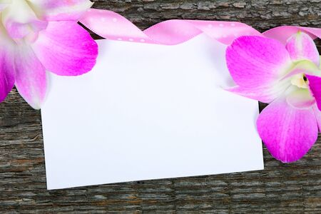 Lilac orchid flowers on old wooden background photo