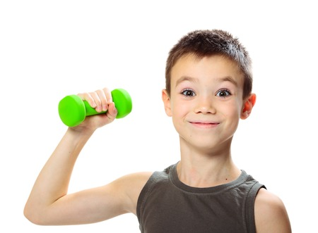 bodybuilding boy: Seven years boy is doing exercises to develop muscles isolated on white background